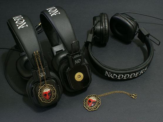 Headphones with vampire character pendants