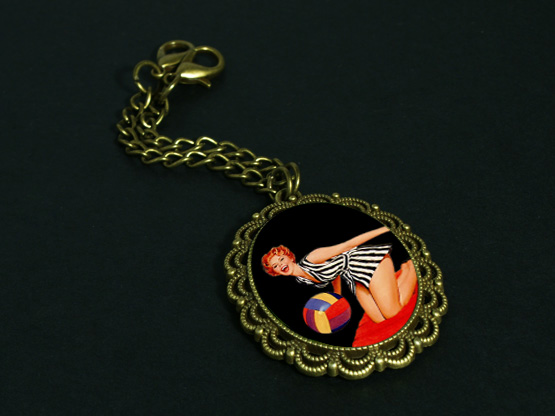 Pinup girl pendant for headphones